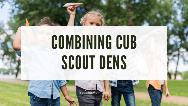 A group of children playing with paper airplanes and the title indicating that this article is about combining Cub Scout dens.