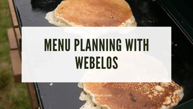 The title Menu Planning with Webelos over an image of pancakes being cooked on a camp griddle.