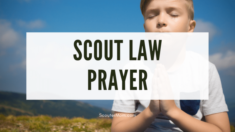 Scout Law Prayer over an image of a boy outdoors with eyes closed and hands folded in prayer.