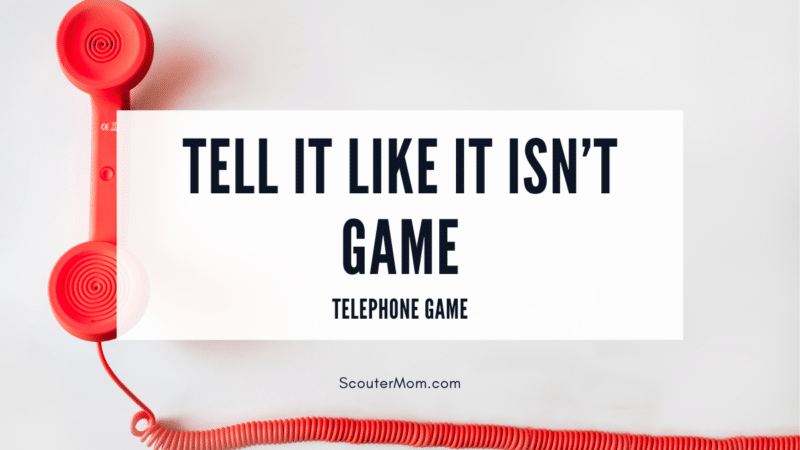 """The title """"Tell It Like It Isn't Game (Telephone)"""" with an image of an old style red telephone with red cord, indicating this is a version of the classic telephone game."""