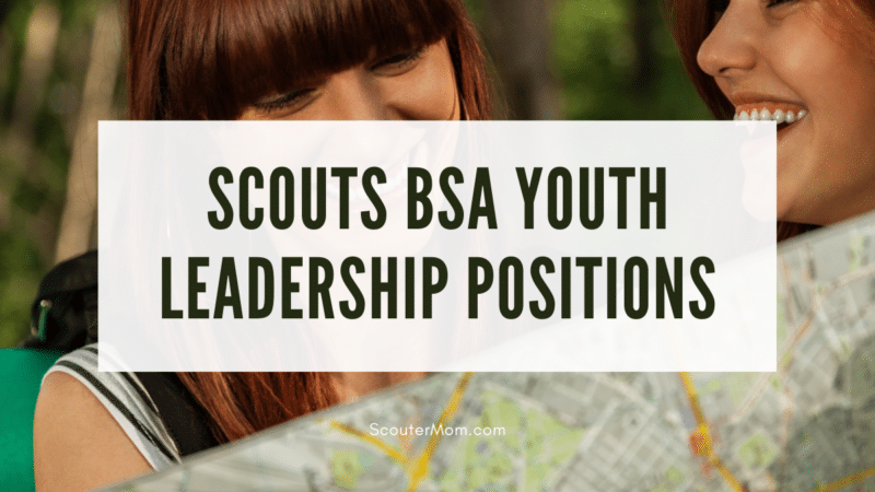 An image of two teen girls planning with a map, just as those in Scouts BSA youth leadership positions do.