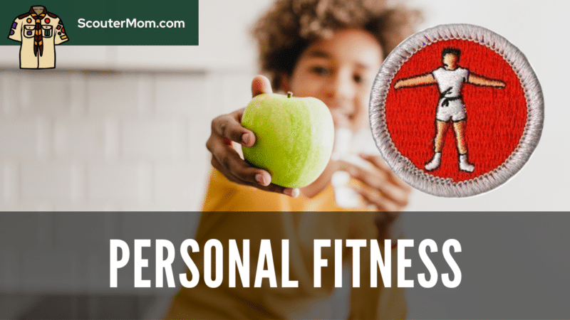 A teen holding out an apple. Nutrition is one aspect of fitness covered by the Personal Fitness merit badge requirements.