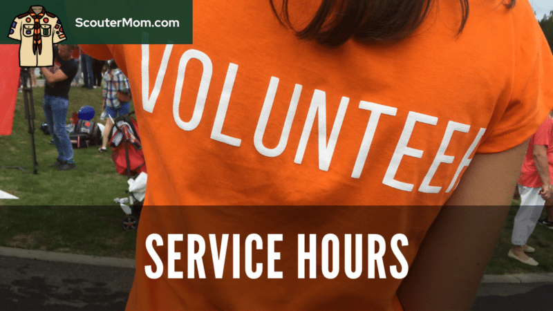 A youth with a volunteer shirt on, completing service hours by working on a community service project.