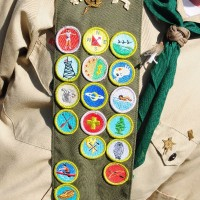 Boy scout wearing his bandoleer with 17 merit badges