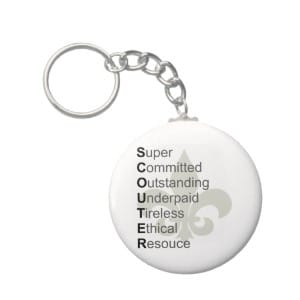 This keychain spells out SCOUTER with Super Committed Outstanding Underpaid Tireless Ethical Resource