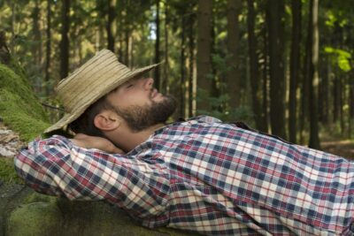 Young Man Relaxing In Nature sleeping