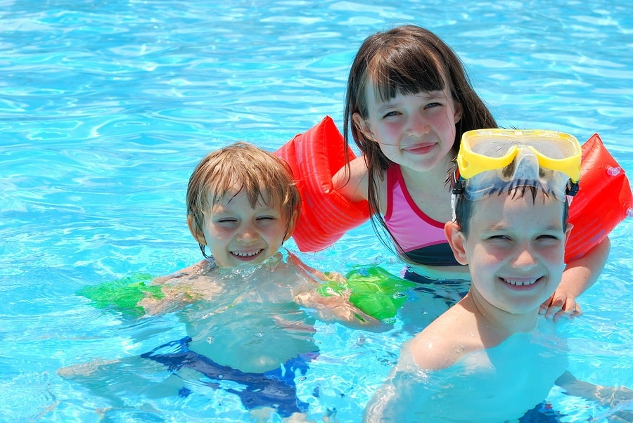 boys and girls in swimming pool